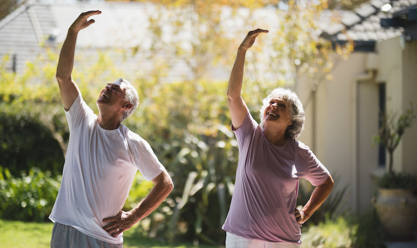 smiling senior couple exercising together VFYGH3J