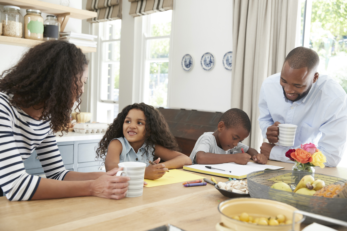 young black family together in their kitchen close MLE36PS